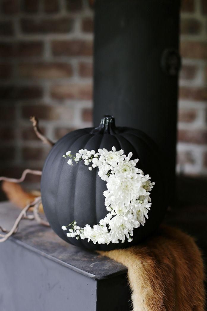 """<p>While this tutorial calls for a black craft pumpkin, you can also spray paint your freshly-picked gourd with a matte black shade before adding on a fresh floral half moon.</p><p><em><a href=""""http://themerrythought.com/diy/diy-fresh-floral-moon-pumpkin/"""" rel=""""nofollow noopener"""" target=""""_blank"""" data-ylk=""""slk:Get the tutorial at The Merrythought »"""" class=""""link rapid-noclick-resp"""">Get the tutorial at The Merrythought »</a></em></p>"""