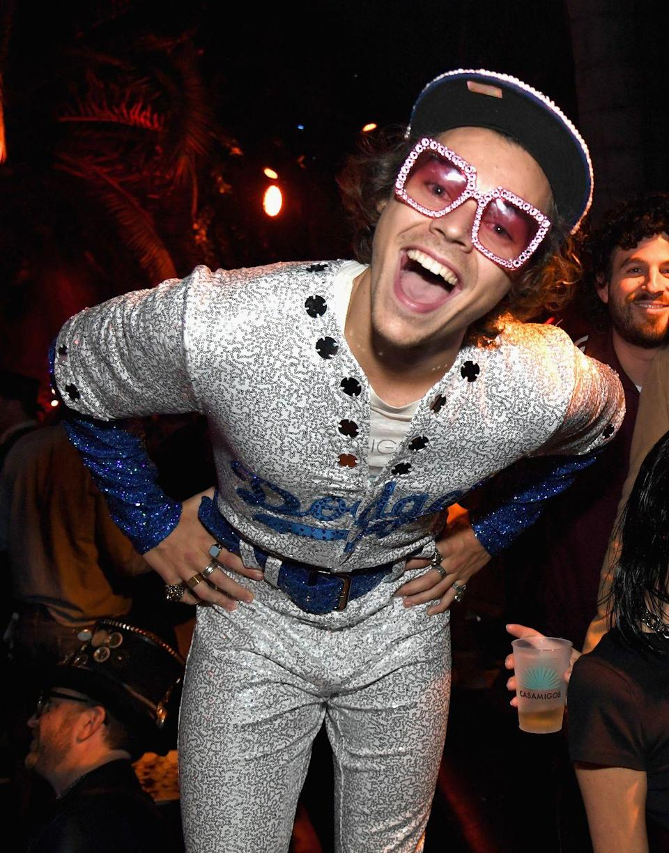 <p>Harry dressed up as another famous British artist, Elton John, for Halloween, donning a super sparkly Dodgers uniform and some classic Elton glasses. Seriously, how cute is he?!</p>