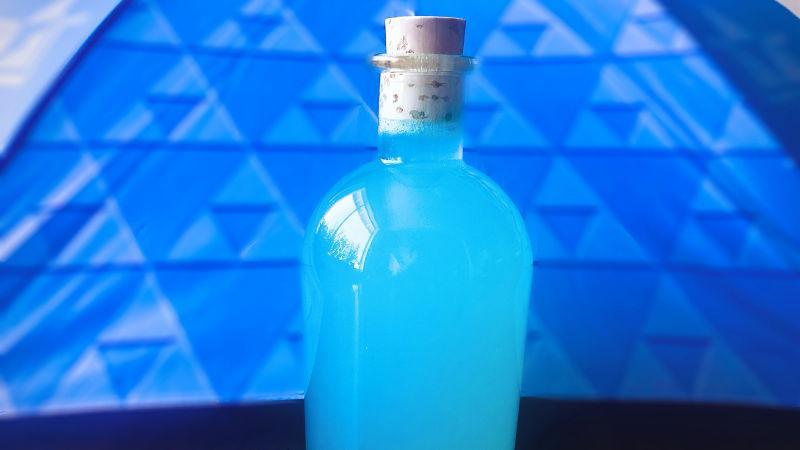 Bright blue cocktail in stoppered bottle