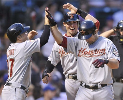 Houston Astros' Brett Wallace right, celebrates with teammates Tyler Greene back, and Jose Altuve left, after hitting a three-run home run against the Chicago Cubs in the third inning during a baseball game in Chicago, Tuesday, Aug. 14, 2012. (AP Photo/Paul Beaty)