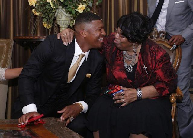 Jameis Winston with his grandmother Myrtle on the night he was drafted first overall by Tampa Bay. (AP)