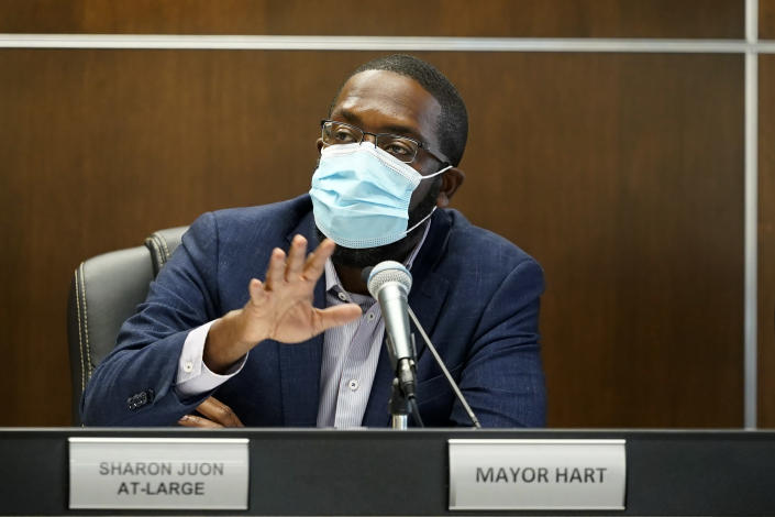 Waterloo Mayor Quentin Hart speaks during a City Council meeting, Tuesday, Sept. 7, 2021, in Waterloo, Iowa. Joel Fitzgerald, the first Black police chief in Waterloo, is facing intense opposition from some current and former officers as he works with city leaders to reform the department, including the removal of its longtime insignia that resembles a Ku Klux Klan dragon. Several of the changes the department has made under Fitzgerald have won praise from Hart, most city councilors and some community leaders — while angering the police union, some retired officers and conservatives. (AP Photo/Charlie Neibergall)