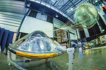 A full-size model of the European ExoMars entry, descent and landing module, Schiaparelli, with its parachute deployed revealed on ESAÕs open day on October 4, 2016 in the Netherlands. ESAÐS. Muirhead/Handout via Reuters