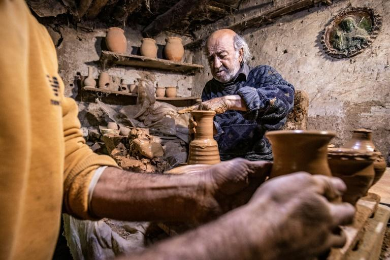 Syrian-Armenian potter Misak Antranik Petros uses an ancient pottery wheel to churn different types of pots at his workshop located inside an ancient mud-brick house near the city of Qamishli in Syria's northeastern Hasakeh province