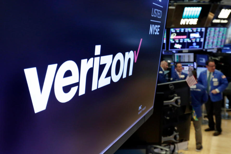 FILE- This April 23, 2018, file photo shows the logo for Verizon above a trading post on the floor of the New York Stock Exchange. Warren Buffett's company made major new investments in Verizon and Chevron and again trimmed its huge stake in Apple while making several other adjustments to its stock portfolio last year. Berkshire Hathaway said in a regulatory filing Tuesday, Feb. 16, 2021, that it bought $8.6 billion worth of Verizon stock and picked up $4 billion worth of Chevron shares over the last six months of 2020. (AP Photo/Richard Drew, File)