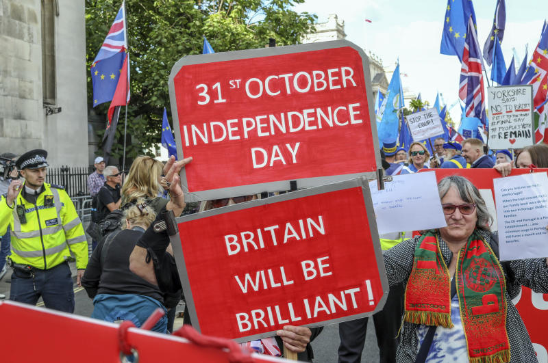 Pro Brexit demonstrators attend a protest at Parliament Square in London, Tuesday, Sept. 3, 2019. Lawmakers returned from their summer recess Tuesday for a pivotal day in British politics as they challenged Prime Minister Boris Johnson's insistence that the U.K. leave the European Union on Oct. 31, even without a withdrawal agreement to cushion the economic blow. (AP Photo/Vudi Xhymshiti)