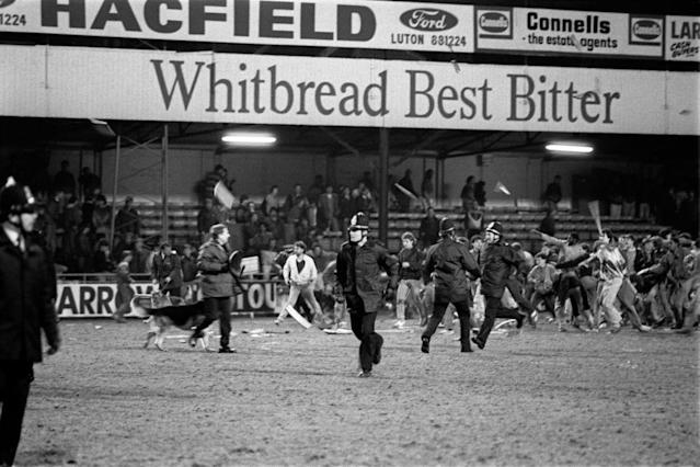 Millwall fans riot, fighting pitched battles with the police, match against Luton (Photo by PA Images via Getty Images)