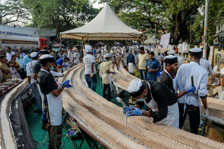 Pending confirmation, the cake is about twice the length of the previous record held by a Chinese fruitcake (AFP Photo/Arun SANKAR                        )