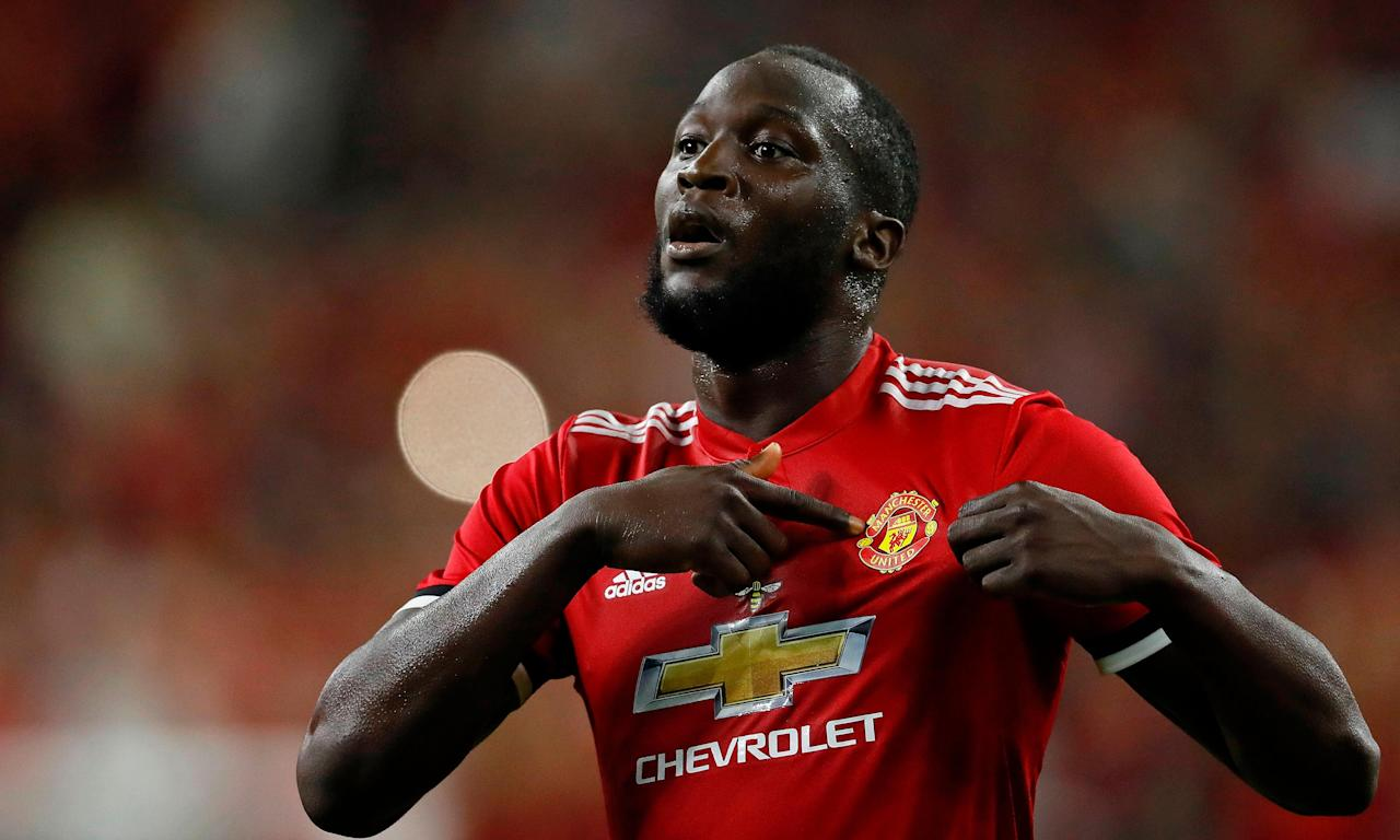 Manchester United striker Romelu Lukaku celebrates after scoring a first-half goal against Manchester City.