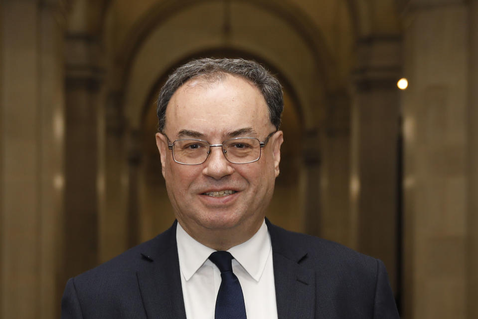 The new Bank of England Governor Andrew Bailey poses for a photograph on the first day of his new role at the central bank in London, Monday March 16, 2020. Andrew Bailey is replacing Mark Carney. (Tolga Akmen/Pool via AP)