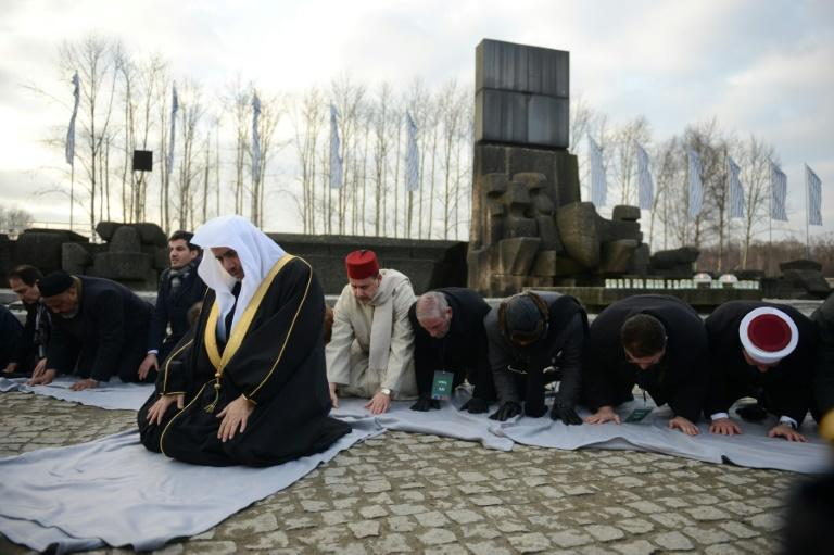 MWL's Mohammad bin Abdulkarim kneels and bows to the ground as he leads Islamic prayers next to the memorial monument