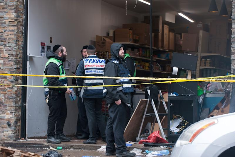 Emergency personnel and investigators work at the scene the day after an hours-long gun battle with two men around a kosher market in Jersey City, New Jersey, U.S., December 11, 2019. REUTERS/Lloyd Mitchell (Photo: Lloyd Mitchell / Reuters)