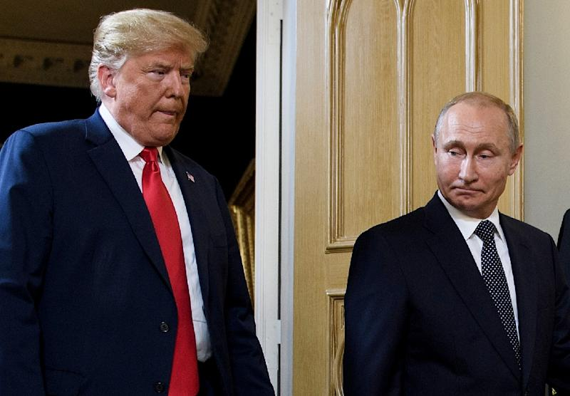 The US has said a new Russian medium-range missile system breaches the INF Treaty and President Donald Trump (L, pictured September 2018) said the country was suspending its obligations under the treaty -- a move mirrored shortly after by Moscow