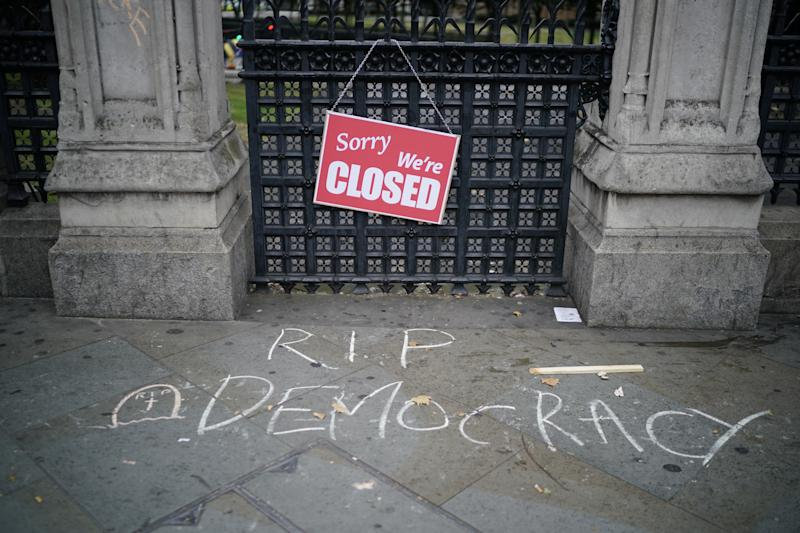 "LONDON, ENGLAND - AUGUST 31: An anti-Brexit sign is displayed on a gate after a protest in Westminster on August 31, 2019 in London, England. Left-wing group Momentum and the People's Assembly are coordinating a series of ""Stop The Coup"" protests across the UK aimed at Boris Johnson and the UK government proroguing Parliament. (Photo by Chris Furlong/Getty Images)"