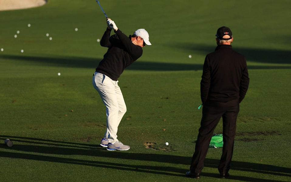 Rory McIlroy of Northern Ireland works with coach Pete Cowen on the range during a practice round prior to the Masters at Augusta National - Getty Images