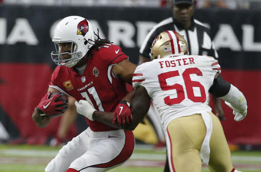 FILE - In this Oct. 28, 2018, file photo, Arizona Cardinals wide receiver Larry Fitzgerald (11) runs with the ball during the team's NFL football game against the San Francisco 49ers in Glendale, Ariz. Fitzgerald is closing in on another milestone, and its an impressive one. The 35-year-old receiver needs to catch just 33 yards of passes Sunday at Kansas City to move past Hall of Famer Terrell Owens into second place in the NFLs all-time yards receiving list. (AP Photo/Rick Scuteri, File)