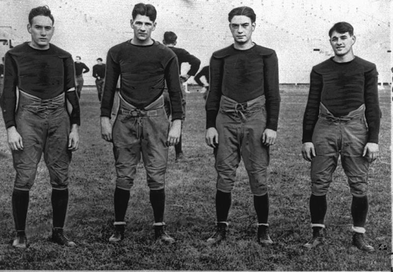 """FILE - In this 1924, file photo, Notre Dame's infamous backfield, """"The Four Horsemen,"""" from left, Don Miller, Elmer Layden, Jim Crowley and Harry Stuhldreherare pose on the practice field in South Bend, Ind. Notre Dame, led by the famed Four Horsemen, finished 10-0 in 1925. There was no national champion declared at the time, but two years later University of Illinois economics professor Frank Dickinson devised a mathematical point system to determine a national champion, Stephens said. Notre Dame coach Knute Rockne persuaded Dickinson to retroactively determine a national champion for the 1925 (Dartmouth) and 1924 seasons. (AP Photo/File)"""