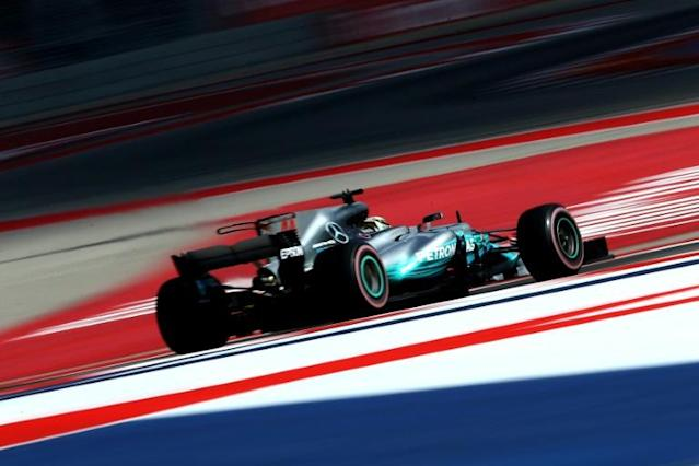 Lewis Hamilton is bidding to equal Michael Schumacher's record of seven world titles this season (AFP Photo/CLIVE ROSE)