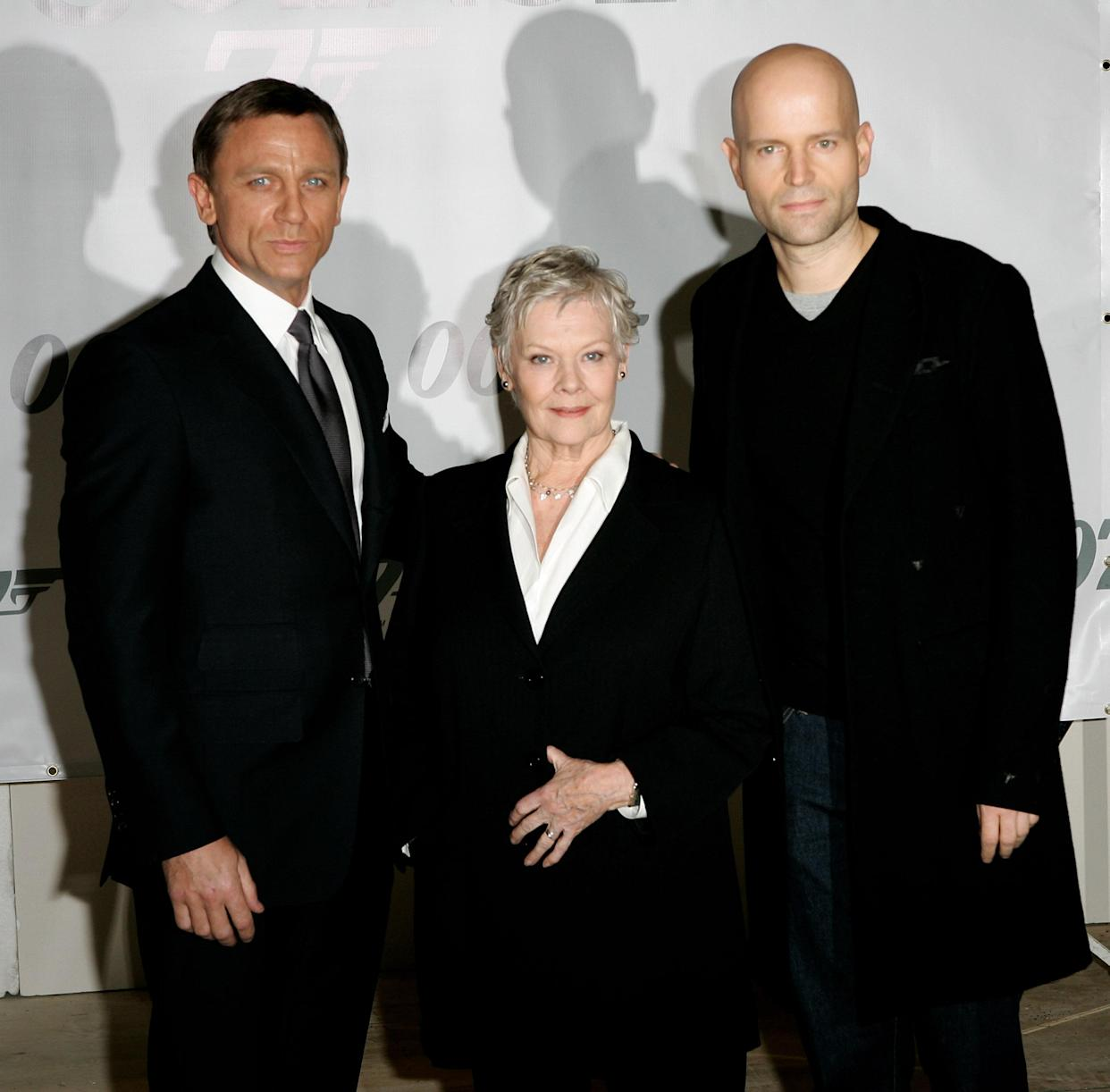 LONDON - JANUARY 24:  Actors Daniel Craig (L) and Dame Judi Dench and director Marc Forster attend a photocall to celebrate the start of production of the 22nd James Bond film 'Quantum of Solace' at Pinewood Studios on January 24, 2007 near London, England.  (Photo by Rosie Greenway/Getty Images)