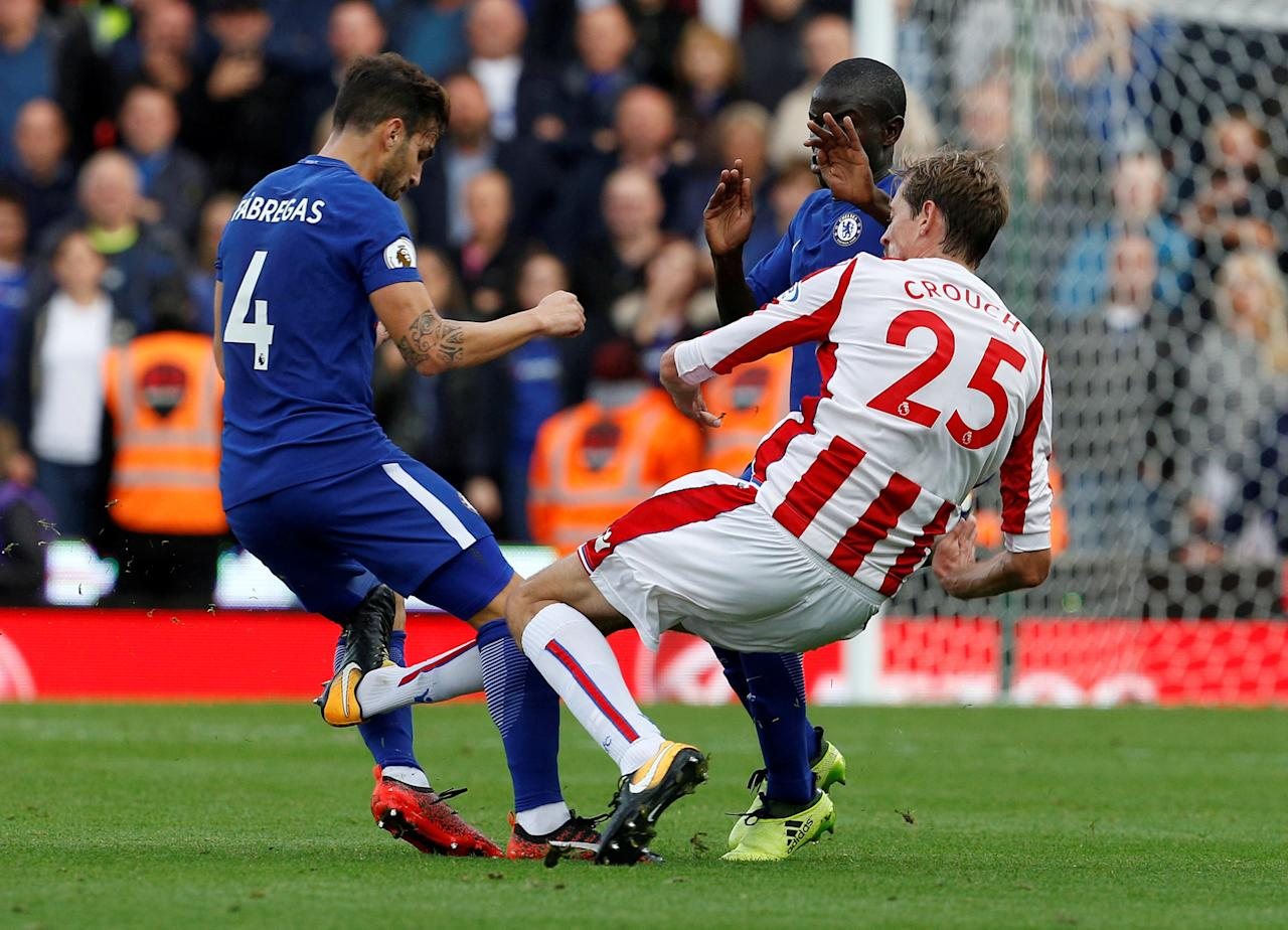 "Soccer Football - Premier League - Stoke City vs Chelsea - bet365 Stadium, Stoke-On-Trent, Britain - September 23, 2017   Stoke City's Peter Crouch fouls Chelsea's Cesc Fabregas to earn a yellow card   Action Images via Reuters/Craig Brough    EDITORIAL USE ONLY. No use with unauthorized audio, video, data, fixture lists, club/league logos or ""live"" services. Online in-match use limited to 75 images, no video emulation. No use in betting, games or single club/league/player publications. Please contact your account representative for further details.     TPX IMAGES OF THE DAY"