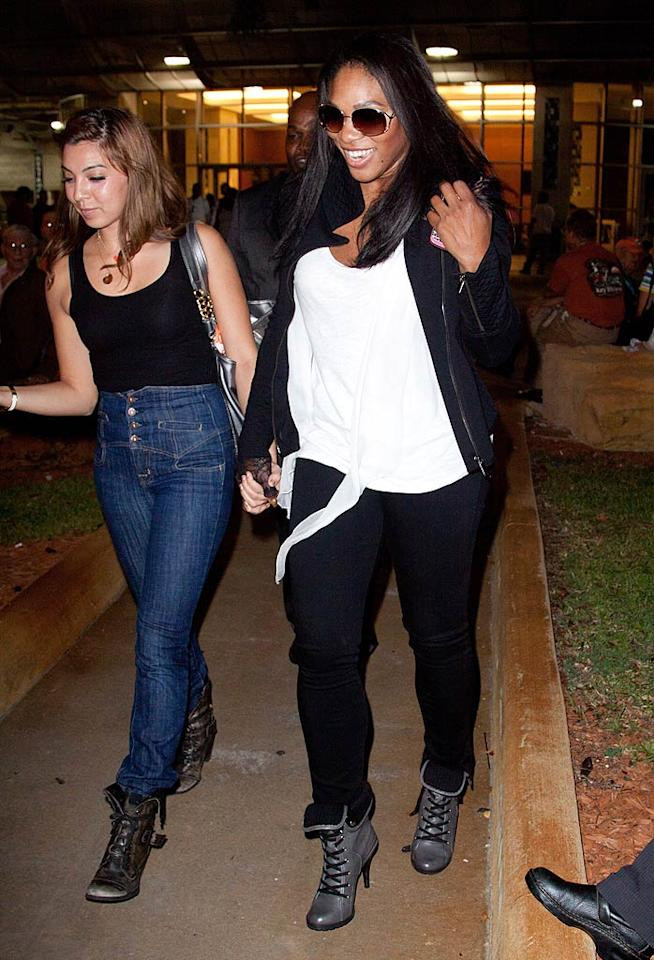 """Tennis star Serena Williams -- who, along with her sister, Venus, is another famous owner of the Miami Dolphins -- was all smiles as she hung with a girlfriend. John Parra/<a href=""""http://www.wireimage.com"""" target=""""new"""">WireImage.com</a> - September 26, 2010"""