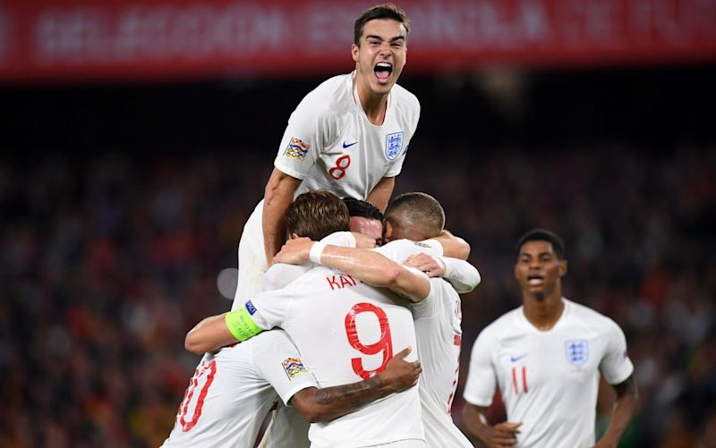 Harry Winks (top) celebrates afterRaheem Sterling put England 3-0 up - Getty Images Europe