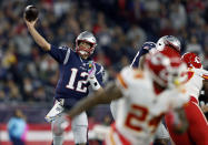 New England Patriots quarterback Tom Brady (12) passes under pressure from the Kansas City Chiefs during the first half of an NFL football game, Sunday, Oct. 14, 2018, in Foxborough, Mass. (AP Photo/Michael Dwyer)