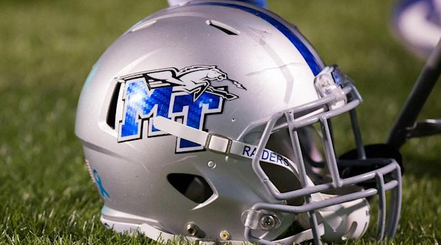 Two Middle Tennessee State football players have been dismissed from the team amid a police investigation into a video of the players striking a dog.