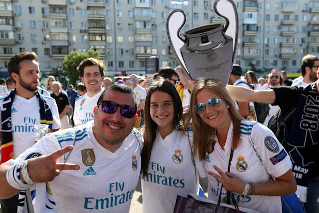 Soccer Football - Champions League Final - Real Madrid v Liverpool - Kiev, Ukraine - May 26, 2018 Real Madrid fans pose for a photo with a replica trophy before the match REUTERS/Viacheslav Ratynskyi