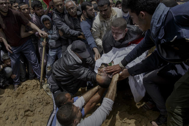 "<p>The last farewell to the Palestinian photographer Ahmad Abu Hussein before being buried at Gaza City's cementery on April 26, 2018. Ahmad Abu Hussein was shot by Israeli forces while he was covering the ""Great March of Return"" protests along the border with Israel. (Photo: Fabio Bucciarelli for Yahoo News) </p>"