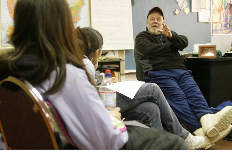 Gary Paulsen, author of stories for young adults, and Iditarod Trial Sled Dog Race veteran, right, talks to the school children at the Nikolai, Alaska school Tuesday, March 6, 2007.