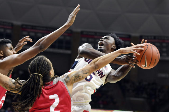 Connecticut's Sidney Wilson, right, attempts to shoot in the first half of an NCAA college basketball game against Sacred Heart, Friday, Nov. 8, 2019, in Storrs, Conn. (AP Photo/Stephen Dunn)