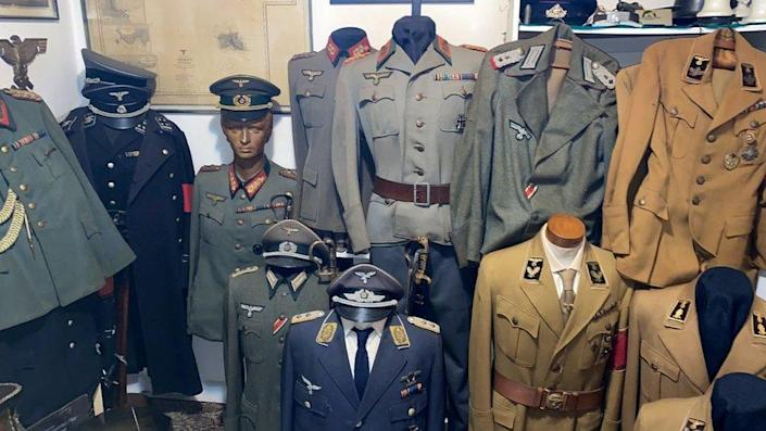 Nazi clothes are seen in a home of an alleged paedophile in Rio de Janeiro