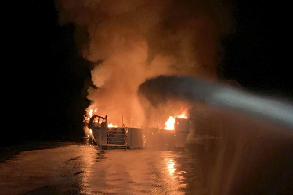 FILE - In this Sept. 2, 2019, file photo provided by the Ventura County Fire Department, firefighters respond to a fire aboard the Conception dive boat fire in the Santa Barbara Channel off the coast of Southern California. The Coast Guard signaled Wednesday, Feb. 10, 2021, that it would undertake a series of recommended safety reforms for passenger vessels in the wake of a 2019 scuba dive boat fire that killed 34 people off the California coast, but a top transportation official cautioned that any changes might take years to enact. The blaze broke out aboard the Conception during the final night of a three-day Labor Day weekend scuba diving excursion near Santa Cruz Island off Santa Barbara. The tragedy marked the deadliest marine disaster in California in modern history. (Ventura County Fire Department via AP, File)