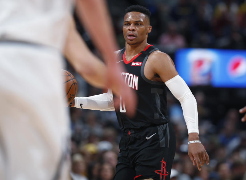 Houston Rockets guard Russell Westbrook looks to pass the ball against the Denver Nuggets in the first half of an NBA basketball game Sunday, Jan. 26, 2020, in Denver. (AP Photo/David Zalubowski)