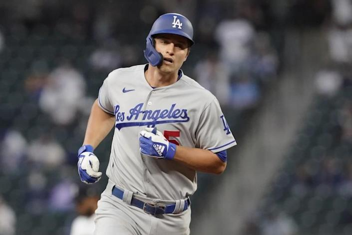 Los Angeles Dodgers' Corey Seager rounds the bases after hitting a two-run home run.