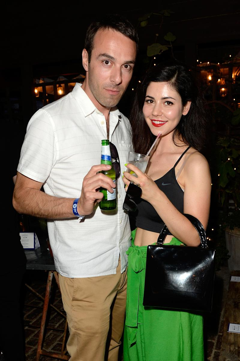 LONDON, ENGLAND - JULY 17: Chairman of Atlantic Records Ben Cook and singer Marina Diamandis attend the Warners & GQ Summer Party at Shoreditch House on July 17, 2014 in London, England. (Photo by David M. Benett/Getty Images for Warners & GQ)