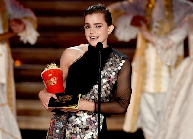 Emma Watson collects her Golden Popcorn trophy. (Photo by Kevin Winter/Getty Images)