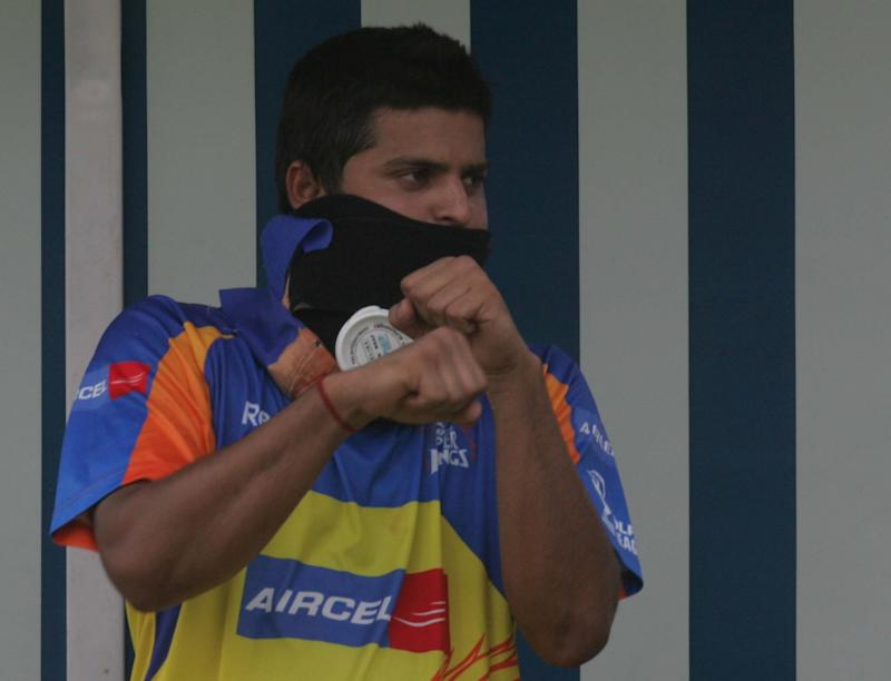 HYDERABAD, INDIA - MAY 26, 2008: IPL Cricket - Team Chennai's Suresh Raina with ice bag suround his neck boxes with teammate L. Balaji during the net practice session on the eve of their match against Team Hyderabad at Rajiv Gandhi stadium on Monday . (Photo by Santosh Harhare/Hindustan Times via Getty Images)