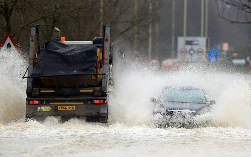 Vehicles negotiate a flooded road in Mountsorrel, Leciestershire - Mike Egerton/PA
