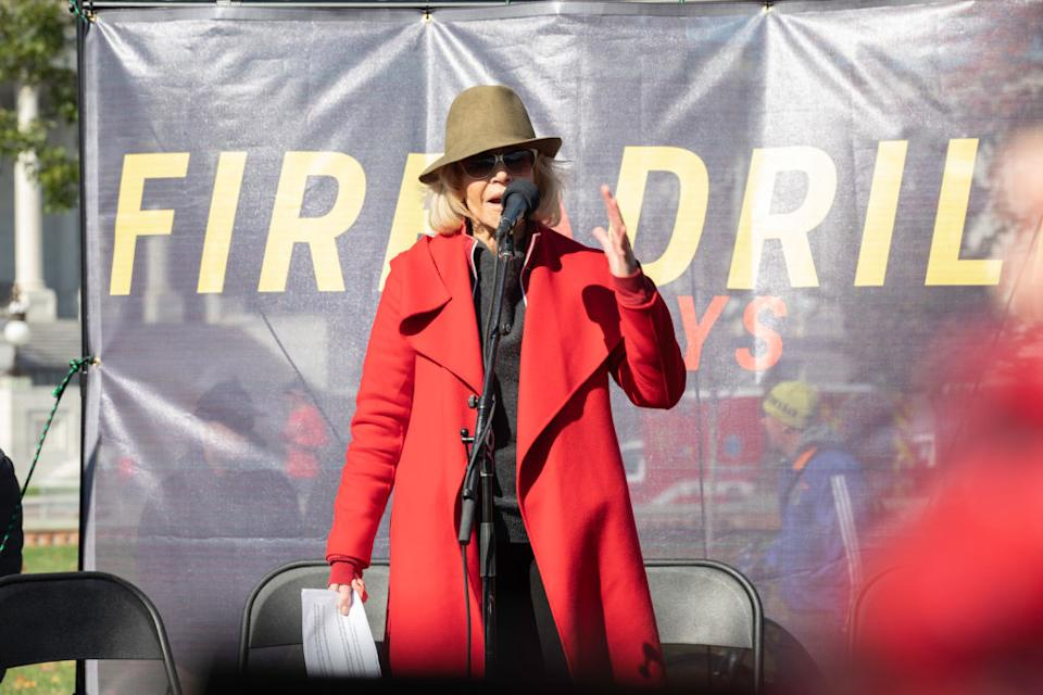 Jane Fonda says her iconic red coat will be the last item of clothing she ever buys [Photo: Getty]