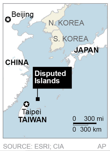 Map locates a disputed chain of islands between China, Taiwan and Japan called Senkaku in Japanese and Diaoyu in Chinese;