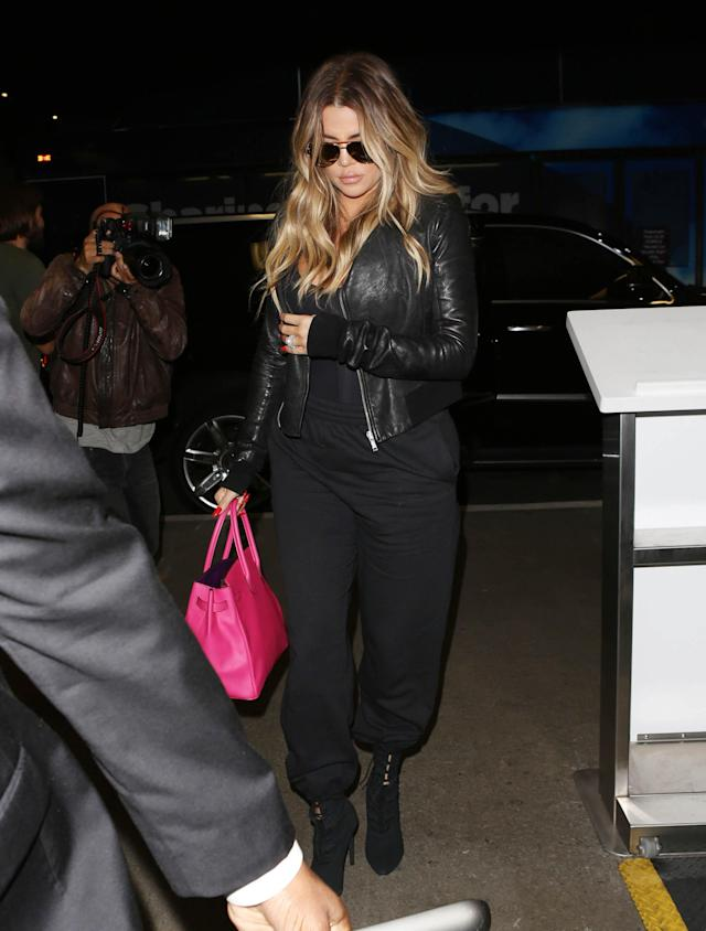 Khloé Kardashian covers up as she steps out on Aug. 2, 2017, in Los Angeles. (Photo: SMXRF/Getty Images)