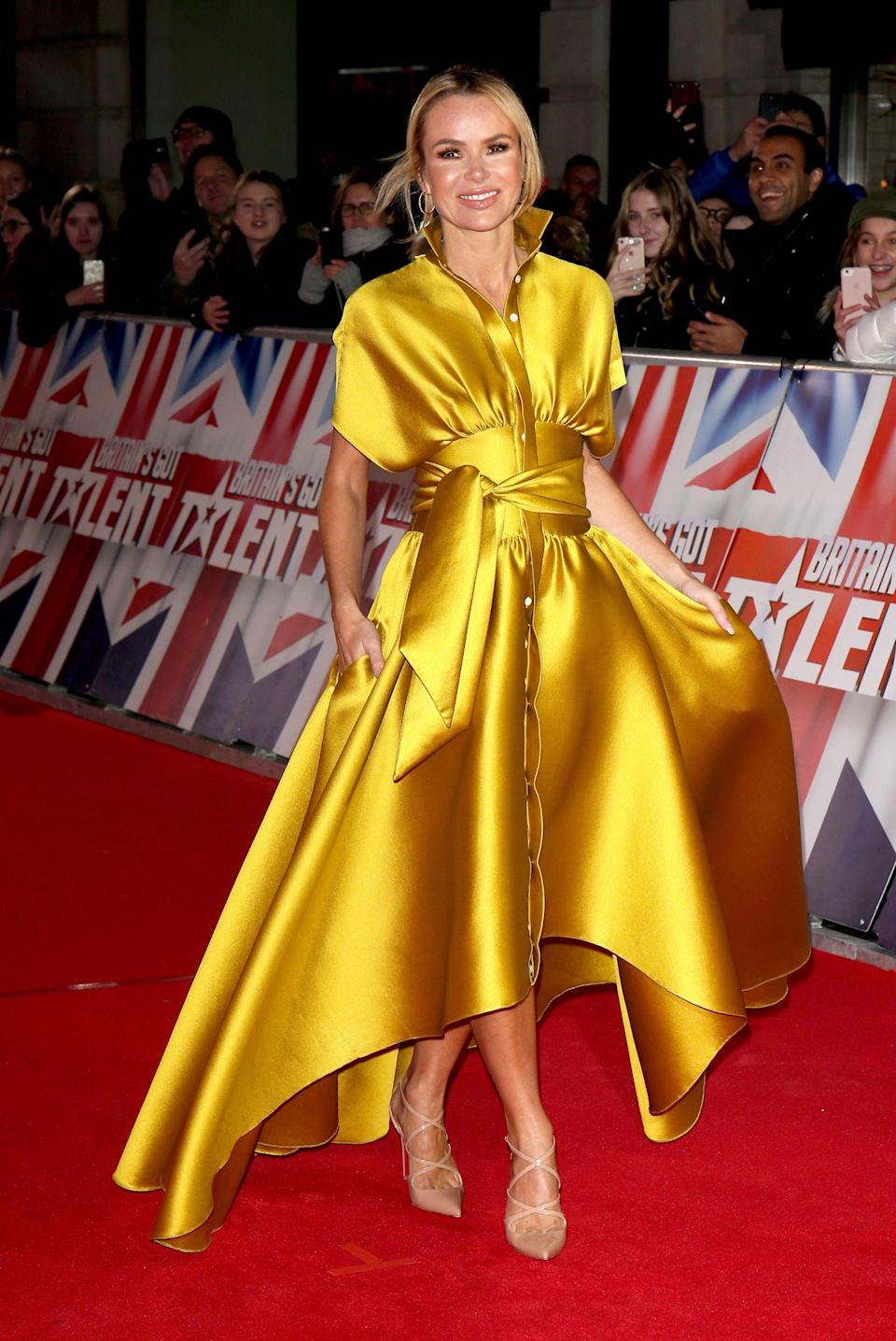 <p>On January 20, Amanda Holden reminded us why she's one of the nation's best dressed in a silky shirt dress by Alexis Mabille. <em>[Photo: Rex]</em> </p>