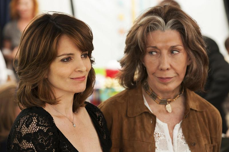"This publicity photo released by Focus Features shows Tina Fey, left, who stars as Portia and Lily Tomlin who stars as Susannah, in a scene from the comedy/drama film, ""Admission,"" directed by Paul Weitz. The movie is a Focus Features release opening March 22. (AP Photo/Focus Features, David Lee)"