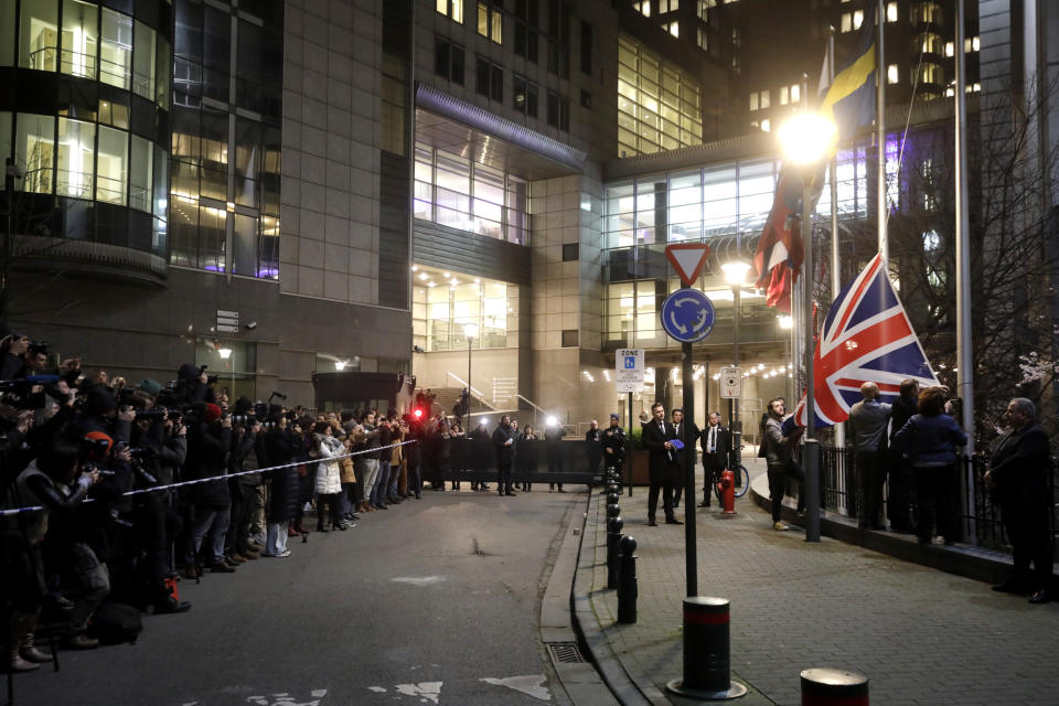 FILE - In this Jan. 31, 2020 file photo, Britain's Union flag is removed from outside of the European Parliament in Brussels. The bloc has been preoccupied for almost four years with Brexit, but now that Britain has left the bloc, the EU hopes to find more time to fix its own problems. (AP Photo/Olivier Matthys, File)