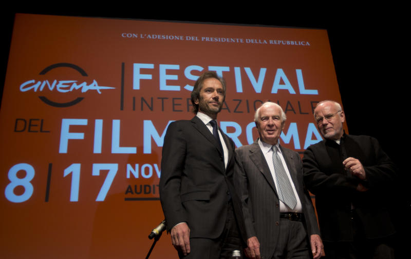 """From left, Lamberto Mancini and Paolo Ferrari, General Director and President of """"Fondazione Cinema per Roma"""", and Rome Film Festival artistic director Marco Muller pose for photographers before they present the 8th edition of the Rome Film Festival at Rome's auditorium, Monday, Oct. 14, 2013. The Festival opens on Nov. 8 and will go on until Nov. 17. (AP Photo/Alessandra Tarantino)"""