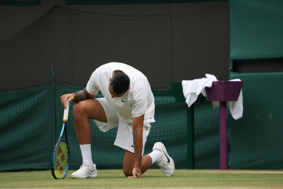 Australia's Nick Kyrgios falls during the men's singles third round match against Canada's Felix Auger-Aliassime on day six of the Wimbledon Tennis Championships in London, Saturday July 3, 2021. (AP Photo/Alberto Pezzali)