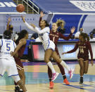 Pittsburgh Emy Hayford (4) drives the lane for a shot under pressure from Boston College's Cameron Swartz in the opening round of the Atlantic Coast Conference Tournament, Wednesday, March 3, 2021, at the Greensboro Coliseum in Greensboro, N.C. (Walt Unks/The Winston-Salem Journal via AP)