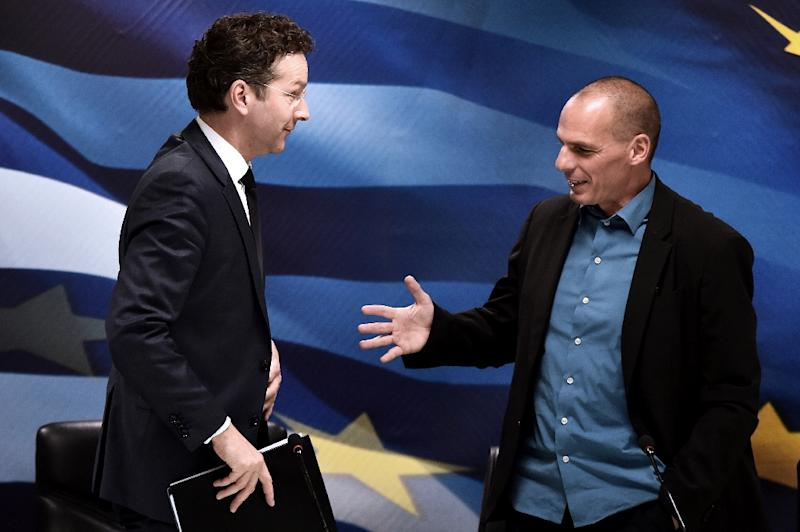 "Jeroen Dijsselbloem (left) says reform proposals by Yannis Varoufakis (right) are ""far from complete"" (AFP Photo/Aris Messinis)"